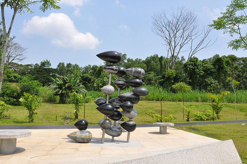 Sculpture Title: 'Another Way To Perceive The Rain Of The Forest' Venue: Jurong Eco Garden, Clean Tech Park, JTC, Time: June 2014 Concept Brief: Based on the basic shape of each JTC Stone, it has been carved into various sizes accordingly. Each JTC Stone has been staked up 'horizontally' based on the visible multiple color layers (black, green, grey) form the side with a slightly slanted 85 degrees installation. The juxtaposition between 'rain droplet' and 'stone' through a unique perceiving way suggested a fascinated visual transformation between the fundamental elements of Mother Nature.
